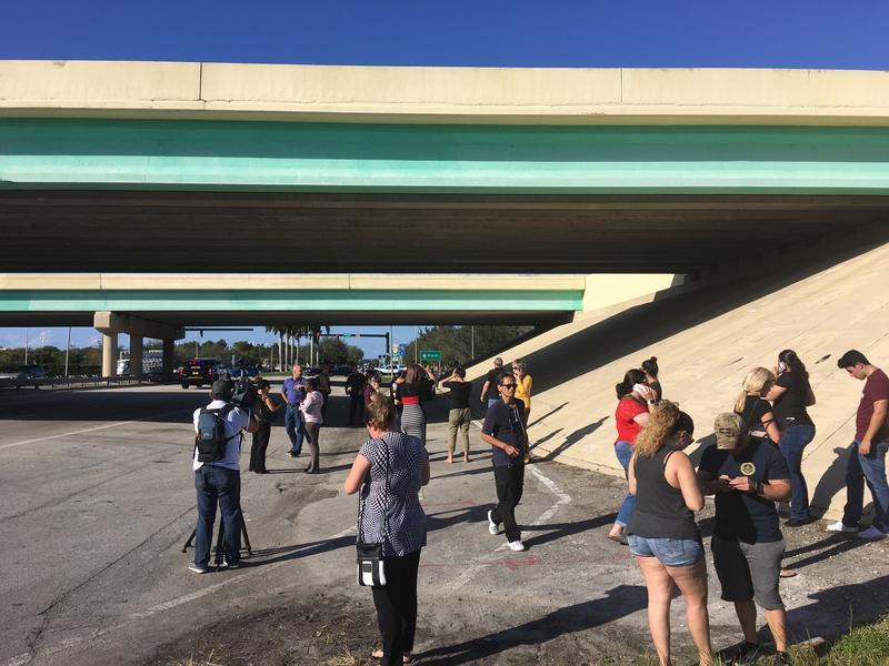 Parents waited at the intersection of Sawgrass Expressway and Coral Ridge Drive, trying to reunite with their children.