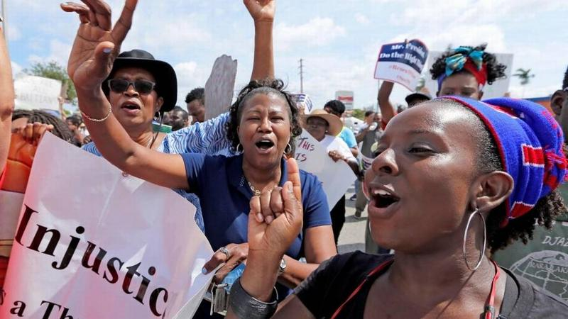 Haitian and immigration advocates hold a rally Saturday demanding the Trump administration extend Temporary Protected Status for Haitians at U.S. Citizenship and Immigration Services office on Saturday, May 13, 2017.