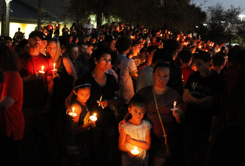 Parents, students and community members gathered at Pine Trails Park for a sunset vigil in honor of the victims of the Marjorie Stoneman Douglas High School shooting