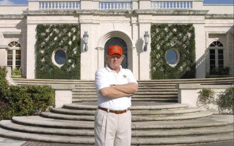 Photographed in 2005, Donald Trump stands in front of 515 N. County Rd., the estate he bought at auction for about $41 million, renovated and then sold in 2008 at a recorded $95 million.