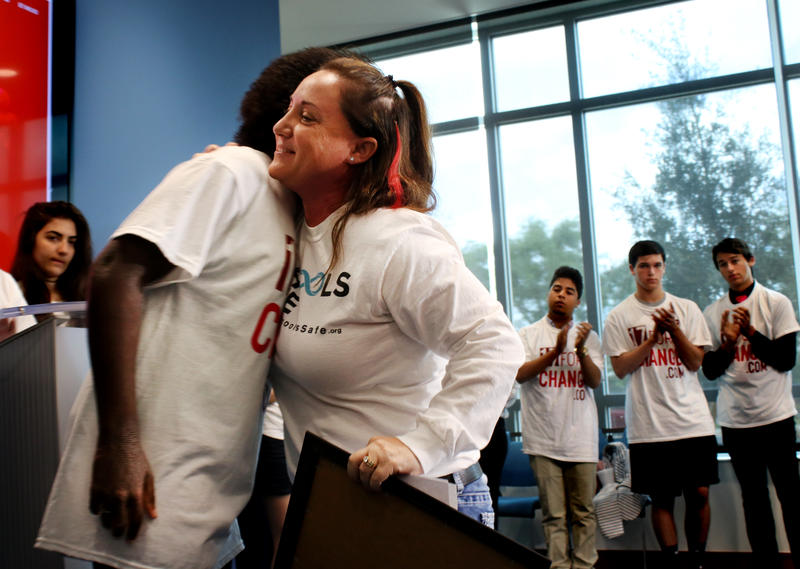 """Lori Alhadeff, center, lost her daughter during the Marjory Stoneman shooting last month. She greets students of """"17 For Change,"""" an organization that promises to keep the momentum for gun reform going."""