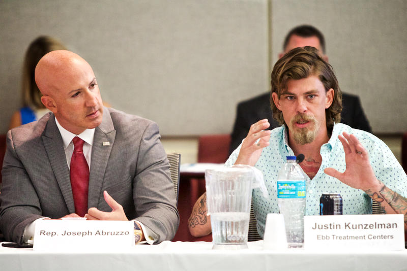 Justin Kunzelman, of Ebb Tide Treatment Centers and Rebel Recovery, urges state lawmakers to increase funding for public naloxone access at a roundtable in West Palm Beach on Aug. 8, 2017.