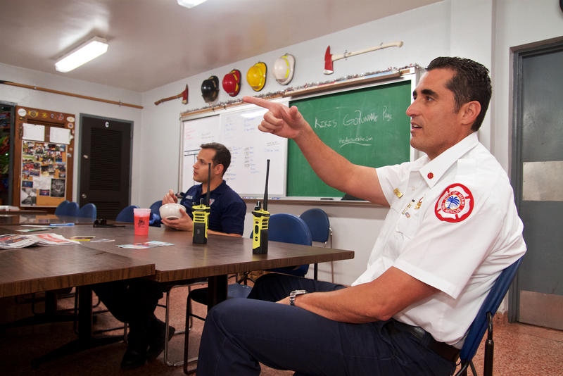 Miami Fire Rescue EMS Battalion Commander R. Vazquez (right) and firefighter-paramedics wait on emergency calls to come in at Miami Fire Station #2 on Feb. 8, 2018.