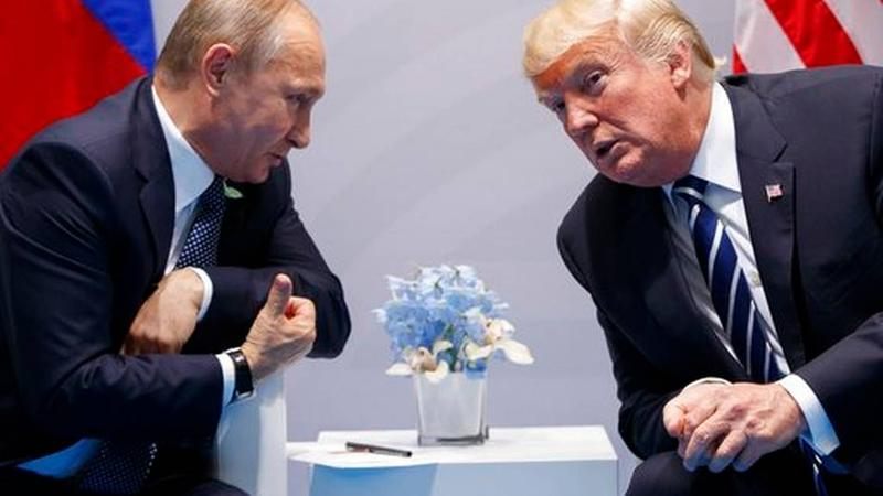 ATTABOY, VLADIMIR! Russian President Vladimir Putin (left) and U.S. President Donald Trump at the G-20 Summit in Germany last year.