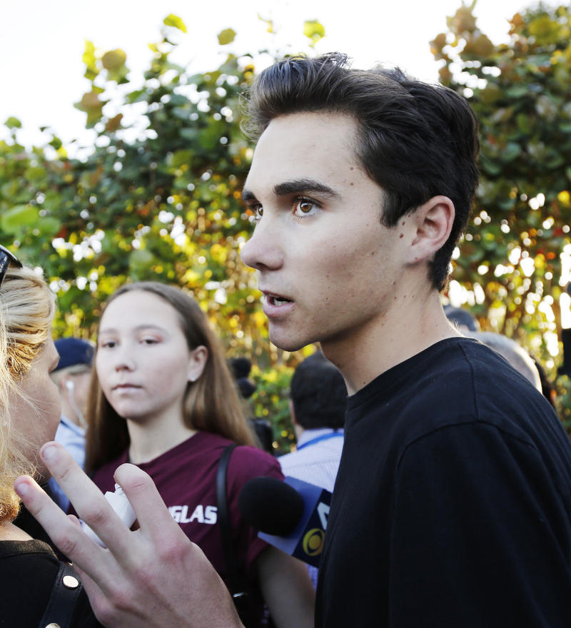 Marjory Stoneman Douglas High School student David Hogg, left, walks to class for the first time since a former student opened fire there with an assault weapon, Wednesday, Feb. 28, 2018, in Parkland.