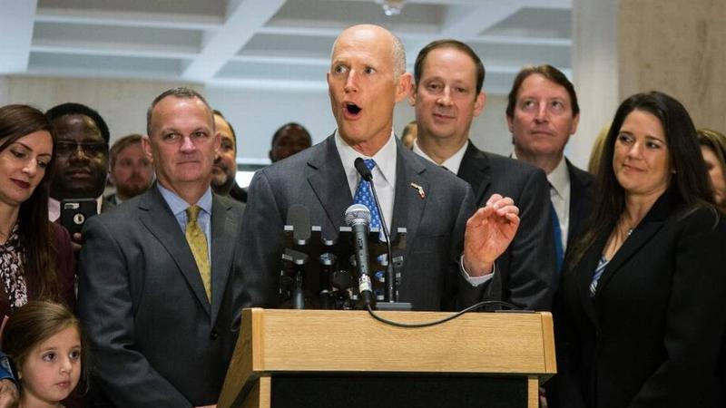 Gov. Rick Scott speaks after the end of the legislative session at the Capitol in Tallahassee, Sunday, March 11, 2018. Flanking Scott are Speaker of the House Richard Corcoran, left, and Senate President Joe Negron.