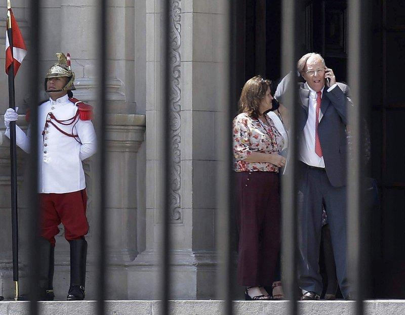 Peru's President Pedro Pablo Kuczynski talks on his cellphone as he leaves the Government Palace also known as the House of Pizarro, in Lima, Peru, Wednesday, March 21, 2018.