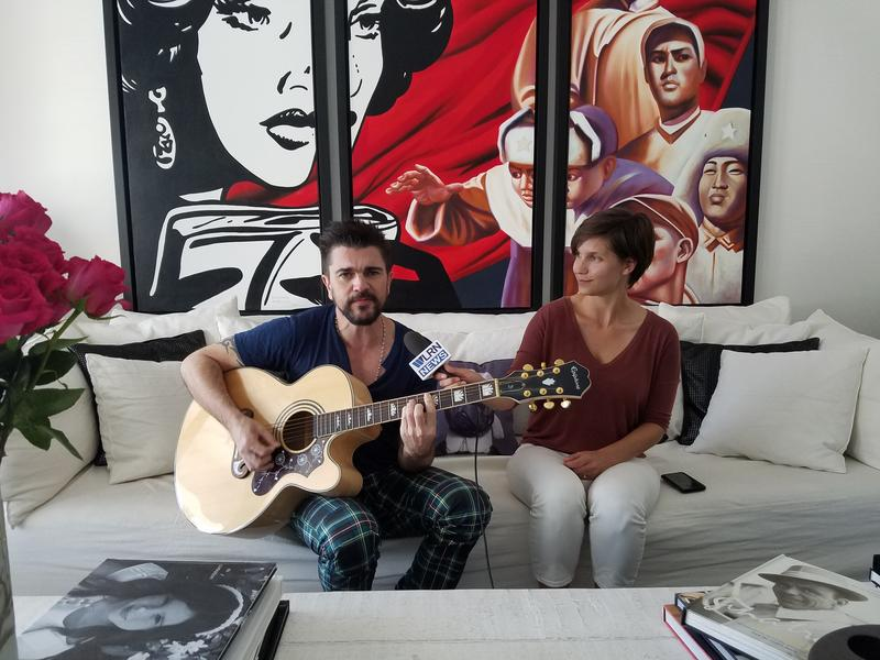 Grammy Award winning artist Juanes sings an original song in his home during a Facebook Live interview.