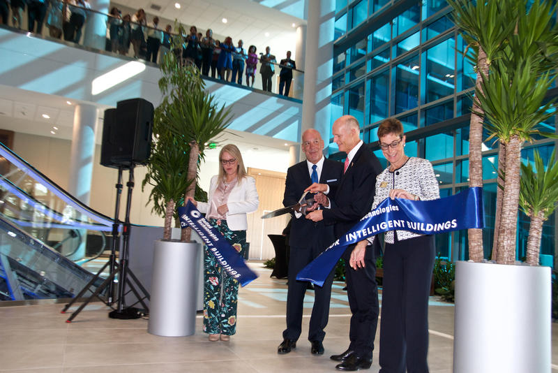 Gov. Rick Scott cuts the ribbon at UTC's Center for Intelligent Buildings in Palm Beach Gardens on Apr. 17, 2018.