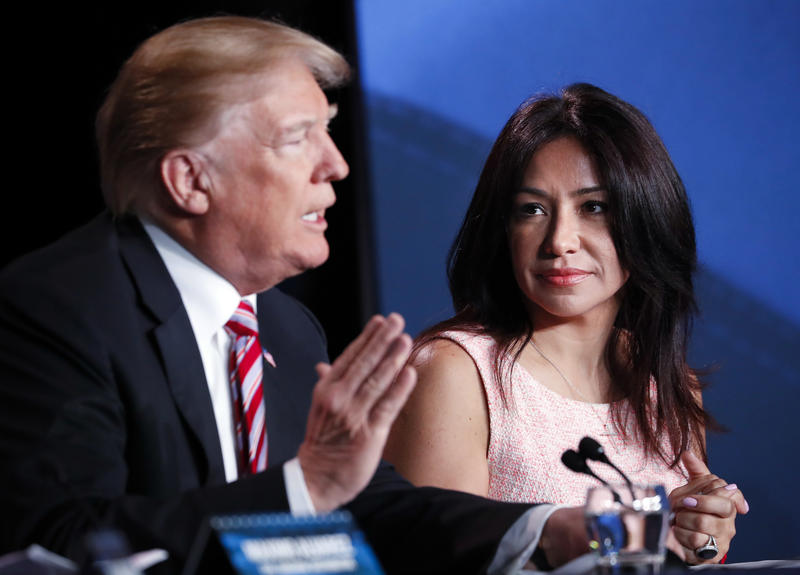 Irina Vilarino, co-owner of the Las Vegas Cuban Cuisine chain of restaurants, listens to President Donald Trump at an event in Hialeah on April 16, 2018.