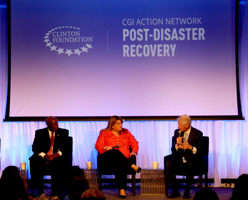 Former President Bill Clinton (right) talks with Puerto Rico Resident Commissioner Jenniffer Gonzalez-Colon (center) and U.S. Virgin Islands Governor Kenneth Mapp at the Clinton Global Initiative Action Network event at the University of Miami on Tuesday.