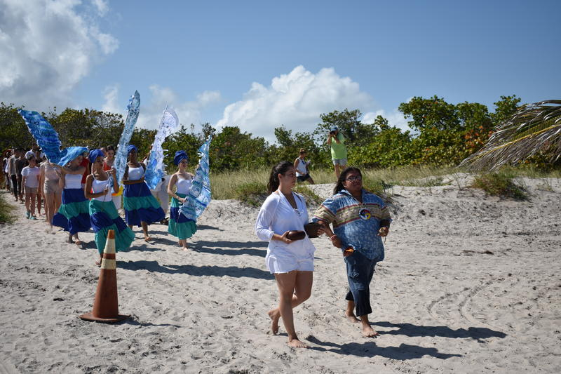 The South Florida National Water Dance performers led by Miccosukee Tribe and water advocate Rev. Houston Cypress in Key Biscayne.