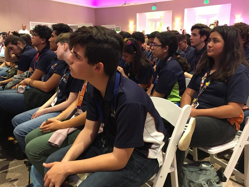 Students listen intently to the astronauts' answers.