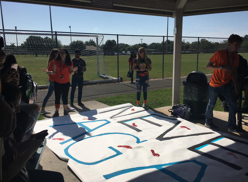 "Marjory Stoneman Douglas students made a ""Never Again"" sign that they will send to their peers at Columbine High."