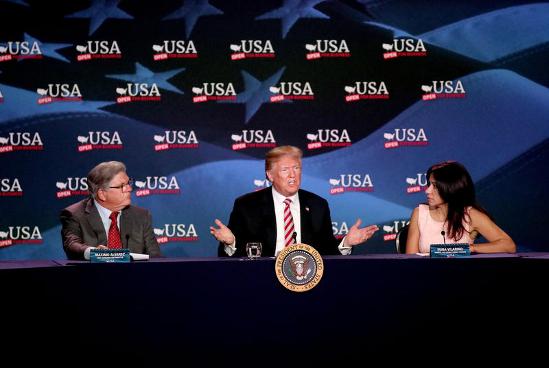 President Trump, center, talk about tax cuts for Florida Small Businesses during a roundtable at Hialeah, Florida on Monday, April 16, 2018. Maximo Alvarez, left, CEO of Sunshine Distributor, and Irina Vilarino, right, owner of Las Vegas Cuban Cuisine.