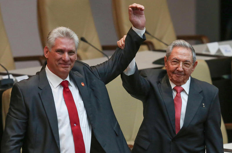 Outgoing Cuban President Raul Castro (right) with new President Miguel Diaz-Canel at the National Assembly in Havana on Thursday.