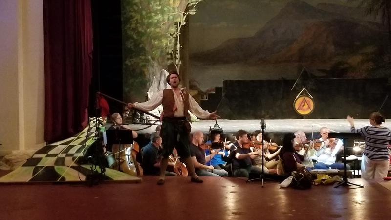 Actor Gabriel Preisser who plays the role of Papageno singing during Tuesday's dress rehearsal.