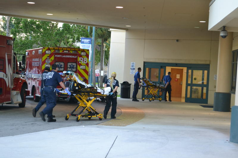 First responders transfer patients from ambulances to Broward Health Medical Center in Fort Lauderdale on the afternoon of Feb. 14. The hospital was on lockdown after receiving victims of the shooting at Marjory Stoneman Douglas High School.