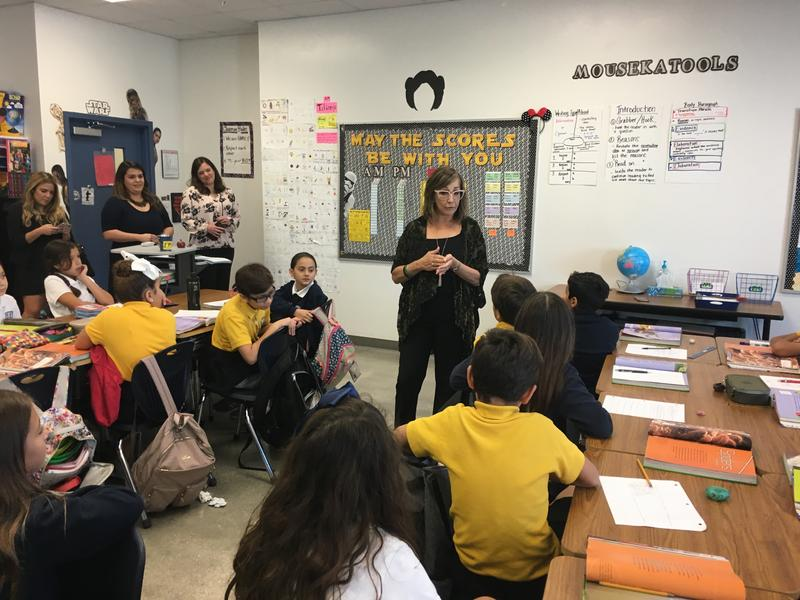 Susie Castillo talks to students at Doral International Math and Science Academy, a charter school in her district. The class' teacher, Geraldine Perez, received a scholarship from a foundation Castillo created to honor her daughter.