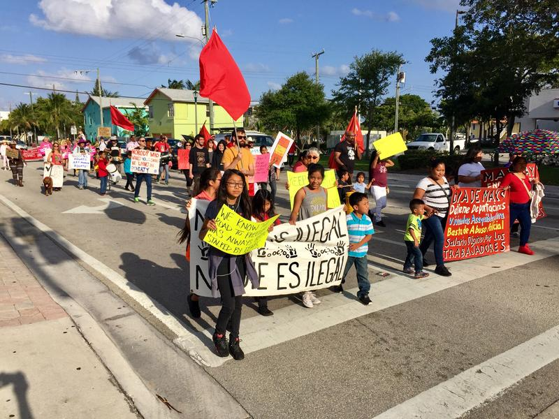 Activists and advocates march through downtown Lake Worth in solidarity of International Workers Day on May 1, 2018.