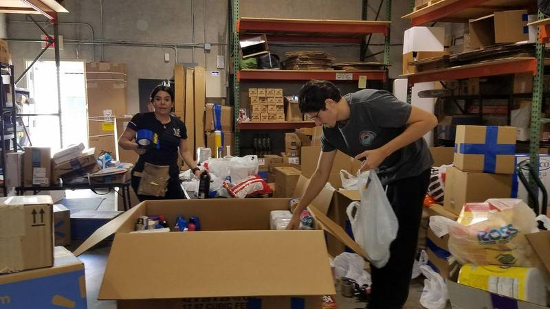 Workers at Vikom Export in Doral prepare packages for shipment to Venezuela.