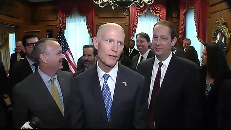 Gov. Rick Scott (center) with House Speaker Richard Corcoran (left) and Senate President Joe Negron (right)
