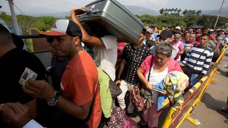 Venezuelan citizens cross the International Simon Bolivar bridge into Colombia on Feb. 21, 2018. As Venezuela's economic crisis worsens, rising numbers are fleeing in a burgeoning refugee crisis.