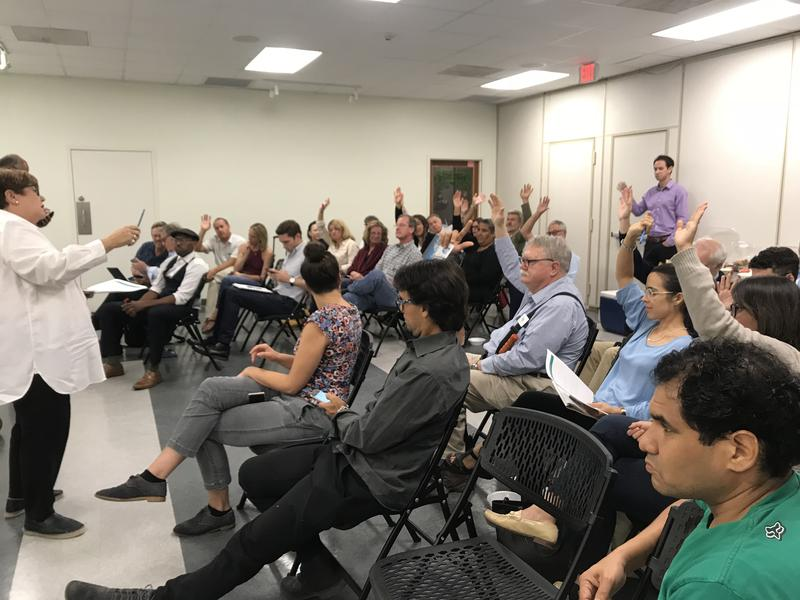 Miami-Dade staff member Tere Garcia polls audience members on adaptation options for flooding in the North Miami neighborhood of Arch Creek.