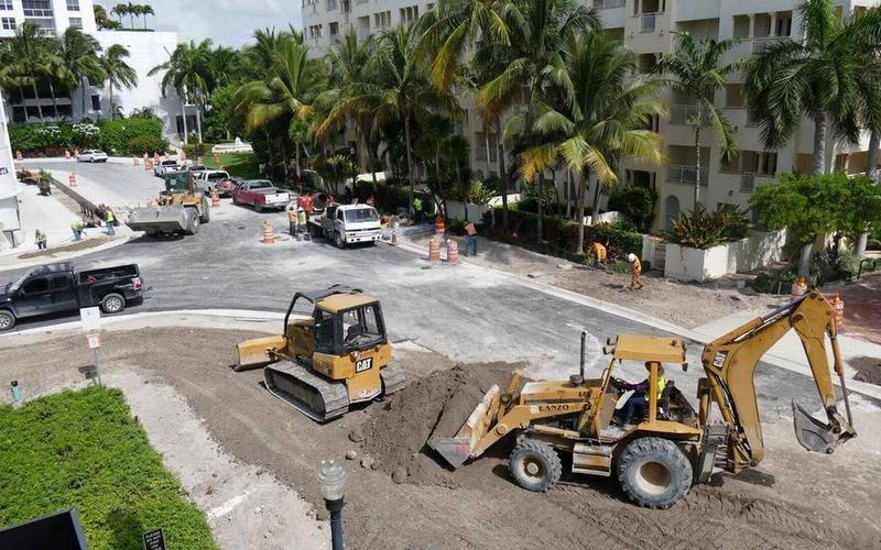 Construction workers raise the height of the street and sidewalks in front of the Publix at 1920 West Ave. in Miami Beach.