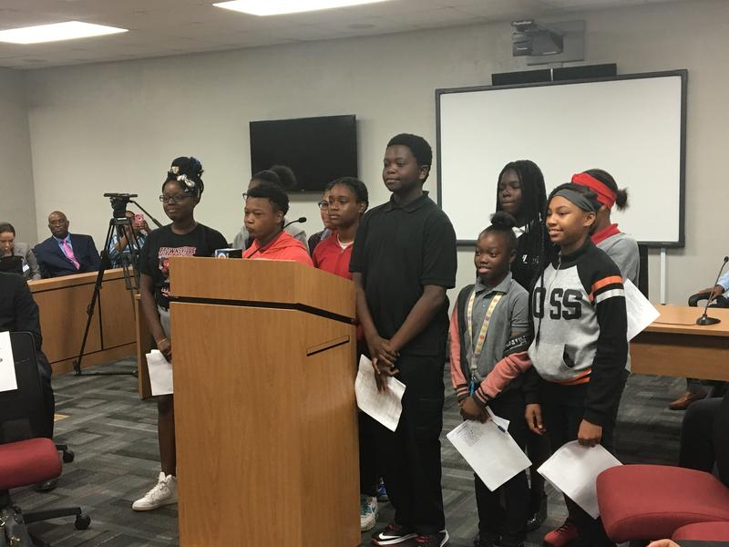 Students address the judge after presenting their mock trial cases.