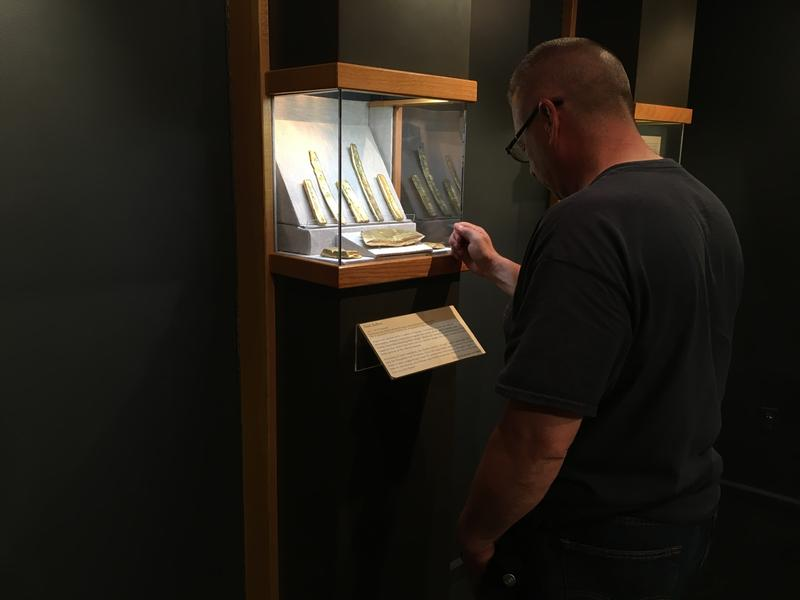 Museum visitors are still fascinated by the gold bars at the Mel Fisher Maritime Museum - but they can no longer touch or lift one.