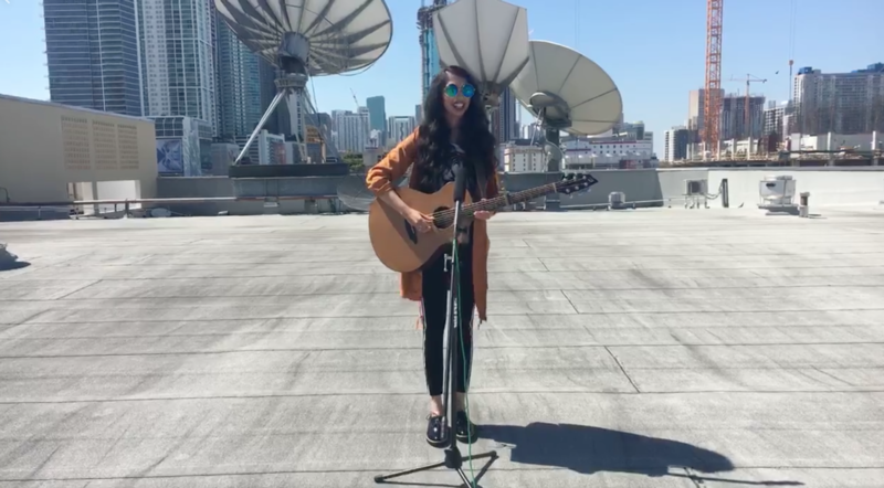 Recording Artist Sonali performing on the WLRN roof during a Facebook Live.