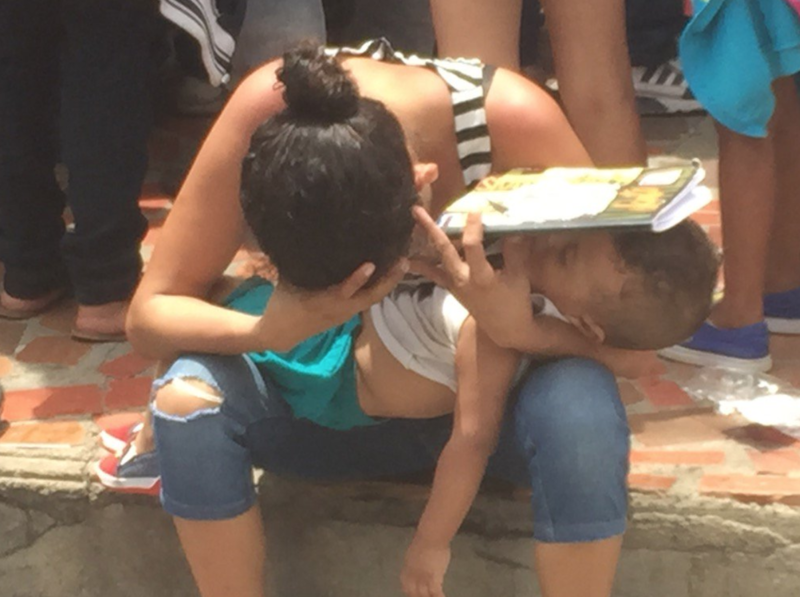 A Venezuelan mother and her baby wait in line, under the sun, in Cucuta to receive food aid from the U.N. Wolrd Food Program.