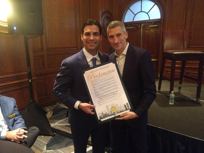 "Miami Mayor Francis Suarez, left, presented a certificate to Daniel Stander, global managing director at Risk Management Solutions, after declaring Tuesday ""Risk Management Solutions Day"" in Miami. RMS's annual conference attracted nearly 1000 attendees."