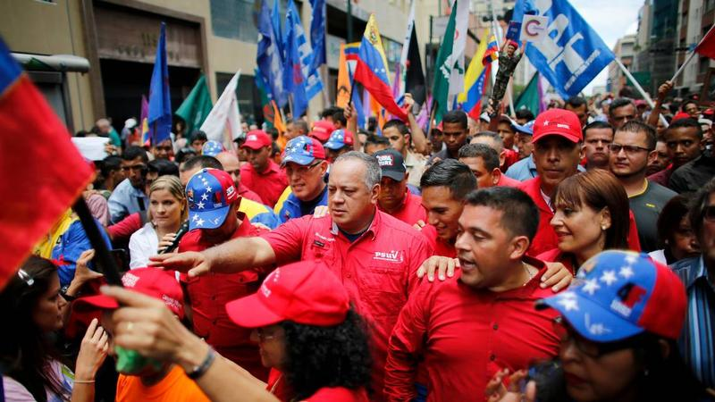 Diosdado Cabello, center, surrounded by bodyguards and supporters during an 'anti-imperialist march' on Aug. 14, 2017.