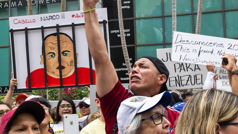 Marcos Carbono, along with hundreds of Venezuelan exiles in Miami, protest the presidential election in Venezuela at the Venezuelan consulate on Brickell Avenue on Sunday, May 20, 2018.