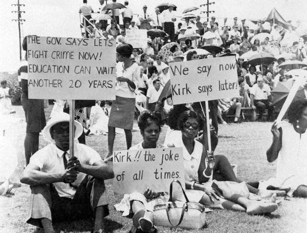 Teachers wave signs protesting Republican Gov. Claude Kirk in 1968, the year Florida was home to the first statewide teacher walkout in history.