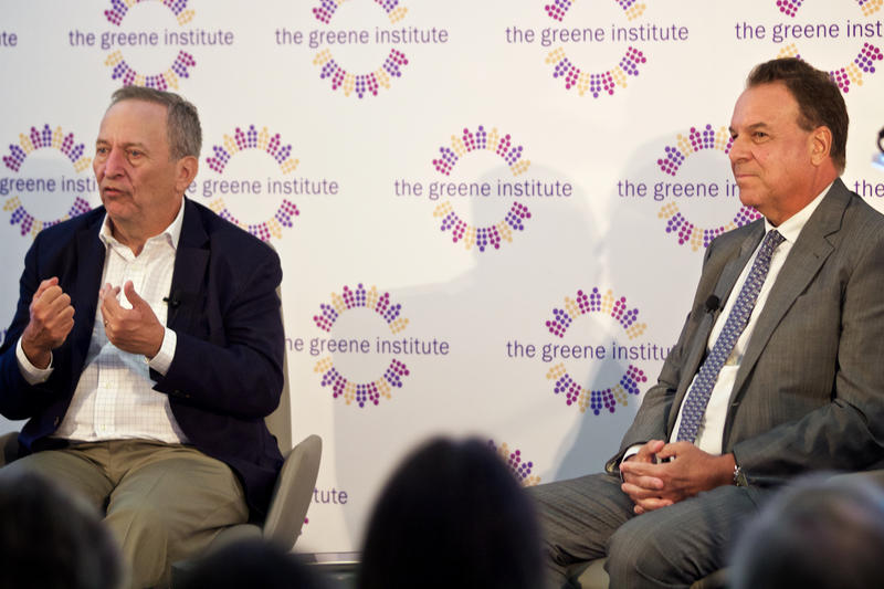 Jeff Greene, right, moderates a discussion on the future of the American workforce with former U.S. Treasury Secretary Lawrence Summers in Palm Beach, Fla. on April 4, 2017.