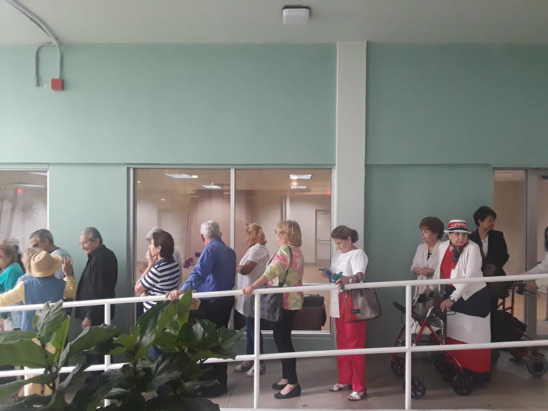 Residents waiting to go into the meeting at 1809 Brickell Avenue, in Miami.