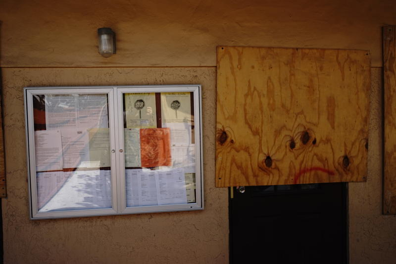 Windows at Turning Point Bridges International are boarded to prevent vandalism