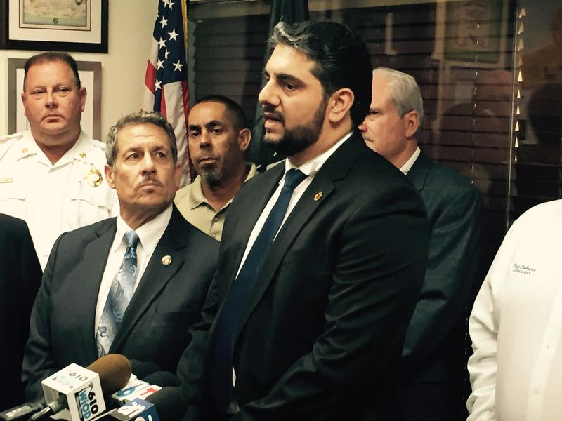 Former Guatemalan volunteer firefighter Federico Cruz joins Miami-Dade Commissioner Jose Diaz (left) and other Miami-Dade officials at Diaz's district offices to call for relief aid donations for Guatemala volcano victims