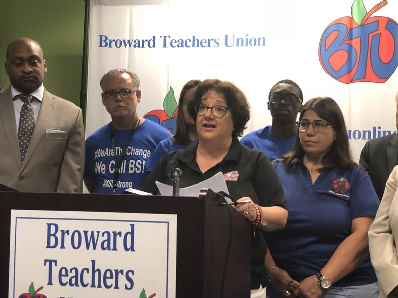 Diana Haneski, the library media specialist at Marjory Stoneman Douglas High School, calls on Gov. Rick Scott to divest the state pension fund from gun companies during a press conference at the Broward Teachers Union headquarters in Tamarac, FL.