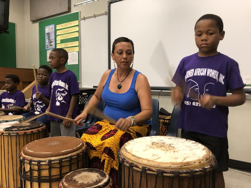 Renee Chavez, center, leads her students in an Afro-Cuban rumba beat. The class is part of a summer camp run by Concerned African Women at Miami Park Elementary School in West Little River, a neighborhood in northwest Miami.