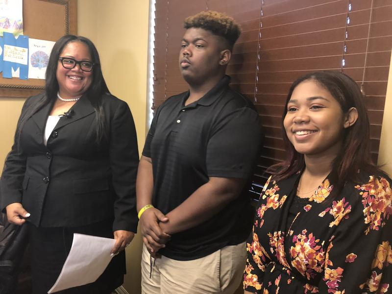 Tenille Decoste, left, announced her candidacy for Broward's school board at her aunt's gynecology practice in Coral Springs, Fla., on Friday. Her kids — recent Marjory Stoneman Douglas graduate Julien, 18, and incoming senior Jada, 17 — joined her.