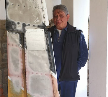 Former Bolivian President Jaime Paz Zamora at his home in Tarija, Bolivia, next to a section of the tail of the plane that crashed in 1980, which was part of an assassination attempt that only he survived.