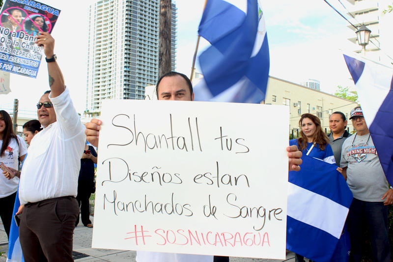 People protest Nicaraguan designer Shantall Lacayo and her ties to Nicaraguan President Daniel Ortega across from Miami Fashion Week on Friday, June 1, 2018.