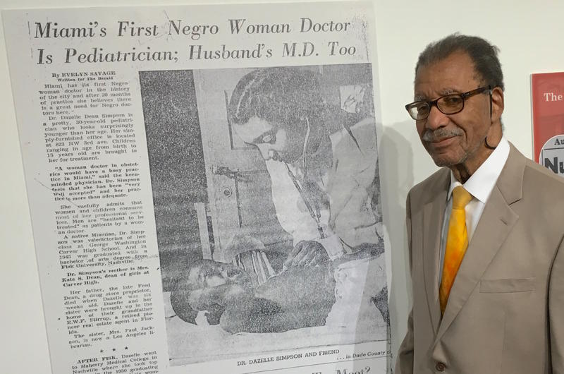 Dr. George Simpson next to a profile of his wife, Dr. Dazelle Simpson. The Simpsons contributed to and are the subjects of a new exhibit on the history of black health care in Miami, Fl.