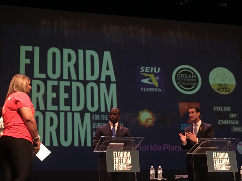 Orlando entrepreneur Chris King (right) answers a question during the Florida Freedom Forum.