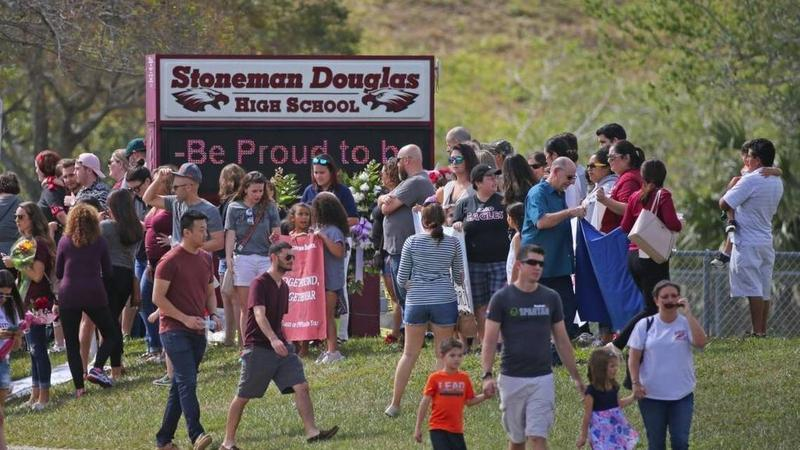 Parents and students return to Marjory Stoneman Douglas High School on Feb. 25, for the first time since the shooting that left 17 dead. Parents of victims are pushing to make schools harder to penetrate.