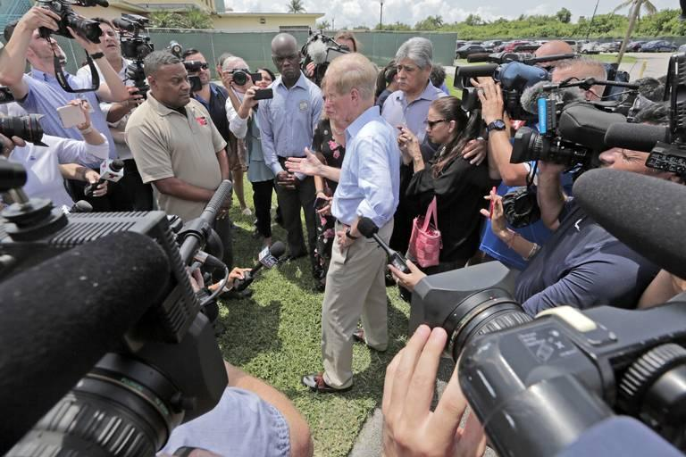 Senator Bill Nelson and Congresswoman Debbie Wasserman Schultz are denied access to the Homestead facility by a security officer, left, as the media stands by.